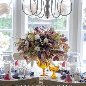 A budget friendly DIY Fall tablescape using vintage amber glass, leaves and flowers found in the backyard- An autumn tablescape in a french country setting.