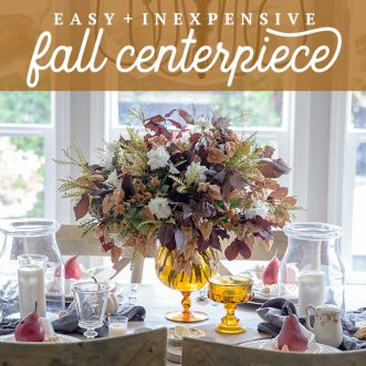 A budget friendly DIY Fall centerpiece using vintage amber glass, leaves and flowers found in the backyard- An autumn tablescape in a french country setting.
