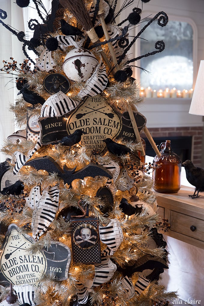 Fun Halloween tree with bats, broomsticks, crows, and vintage witch accents.