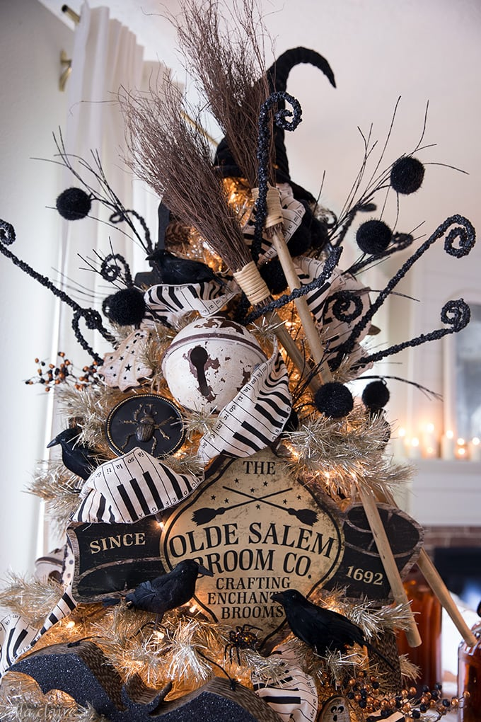 Rusty bells, vintage witch broomsticks on a fun halloween tree