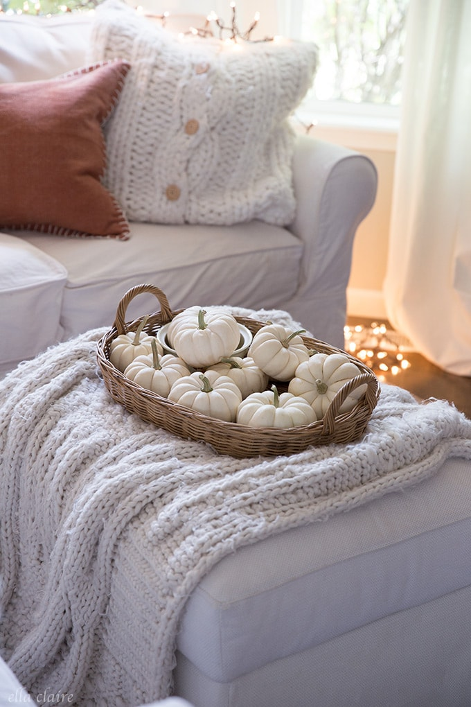 basket of white pumpkins- a simple fall and halloween decoration