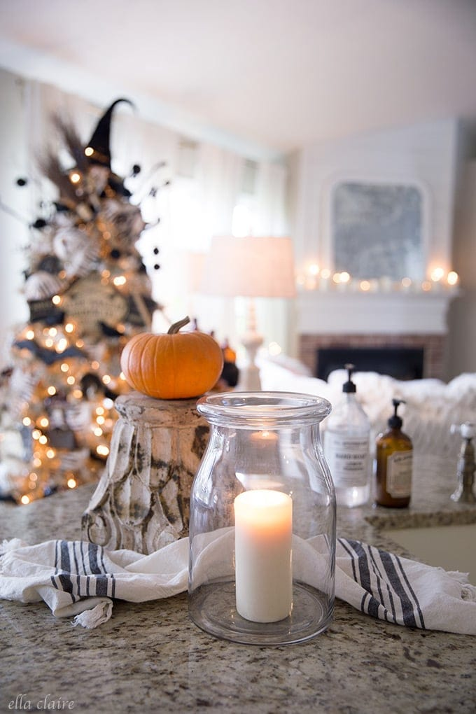Halloween home with a fun DIY vintage Halloween tree, candlelight and a spooky table for entertaining.