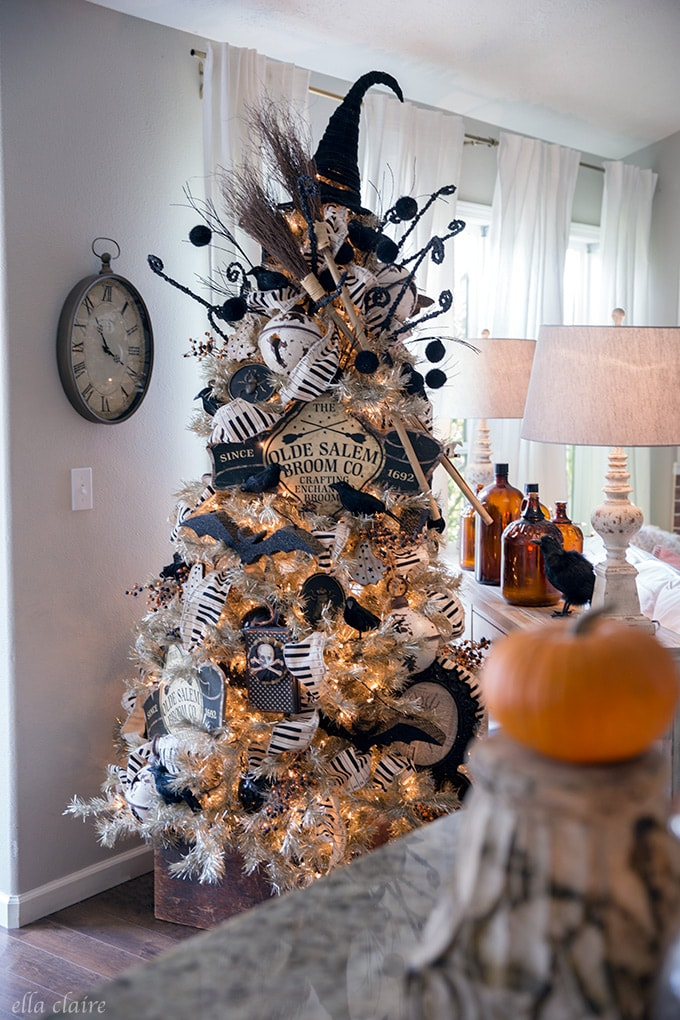 DIY Halloween tree with a vintage witch and broom theme