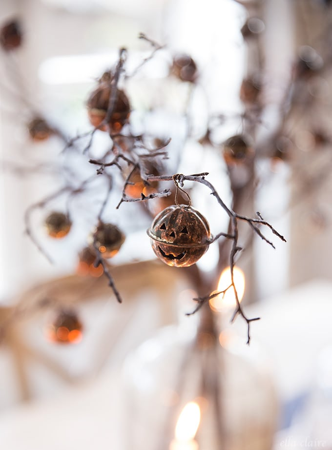rusty pumpkin bells in a halloween centerpiece