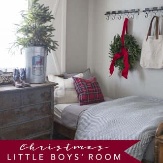 How to add Farmhouse Christmas decorations to a well-used little boys room. A boy's room decorated for Christmas with red and navy accents, faux and fresh greenery.