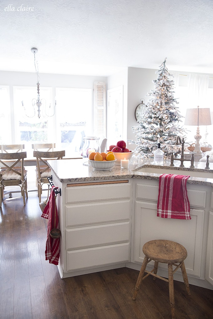 Red accents, pomegranates, and oranges are a simple and easy way to add Christmas cheer to a kitchen