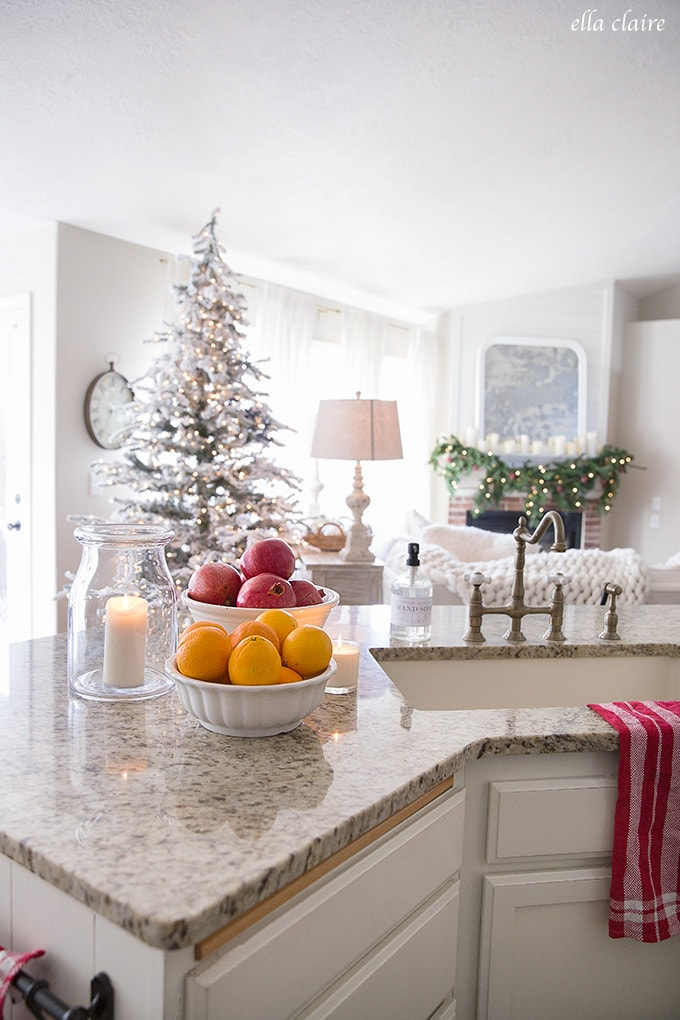 Candlelight and Red accents, pomegranates, and oranges are an easy way to add Christmas cheer to a kitchen for the holidays