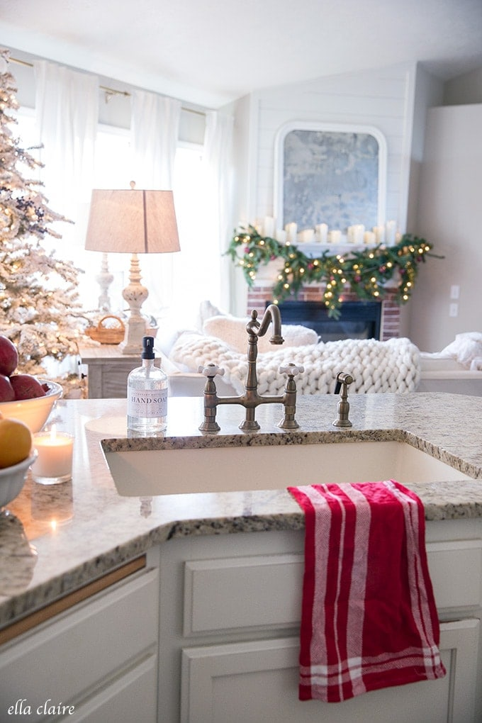 Christmas kitchen sink overlooking the warm glow of twinkle lights and cozy Christmas touches.