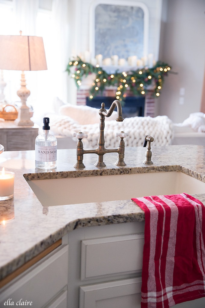 Towels are an easy and inexpensive way to add pops of red to a kitchen for Christmas