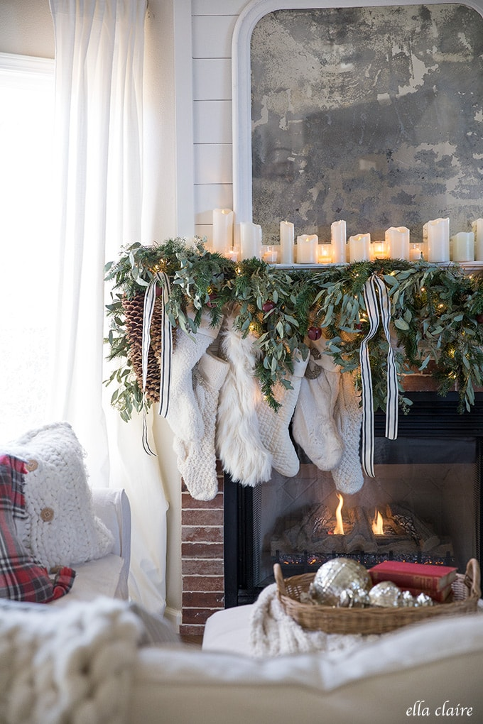 stockings hung by the chimney with care- a collection of different white stockings in a nostalgic, vintage inspired Christmas family room.