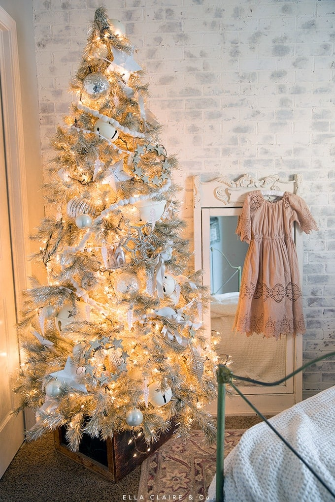 I sweet blush and cream little girl's room all decked out for Christmas- with a vintage tinsel tree antiques, and holiday decorations.