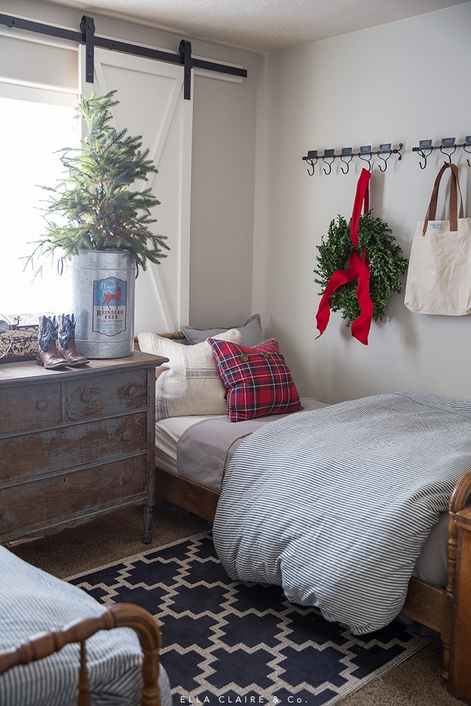 A Little boy's room decorated for Christmas with red and navy accents.