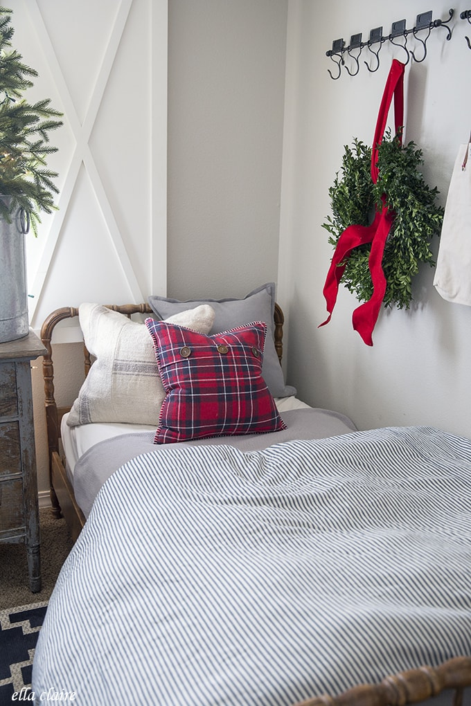 Farmhouse little boys room with red, blue, gray, plaid and a Christmas tree in a bucket
