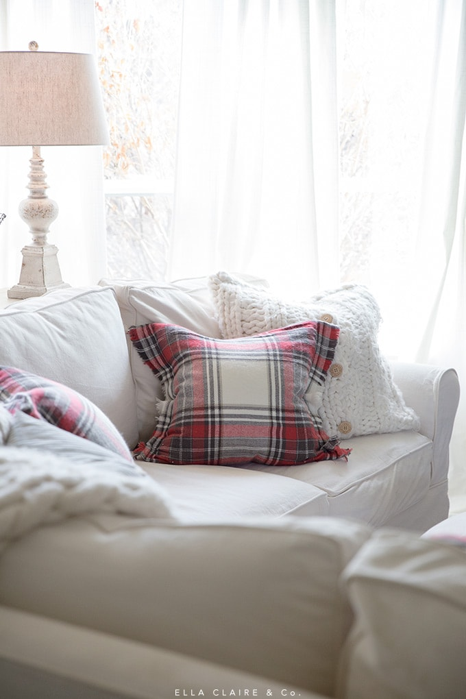 Classic plaid Christmas pillows accent this holiday home with effortless comfort.
