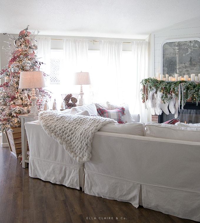 A comfortable and Cozy Christmas Family room with traditional red holiday decor.