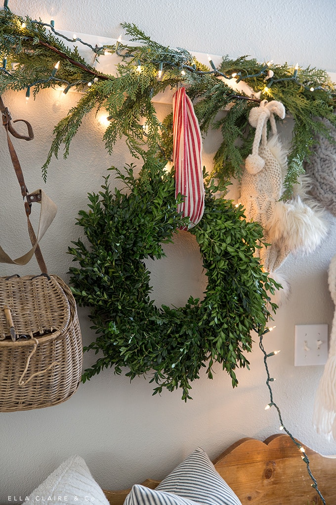 A boxwood wreath in an entryway for Christmas
