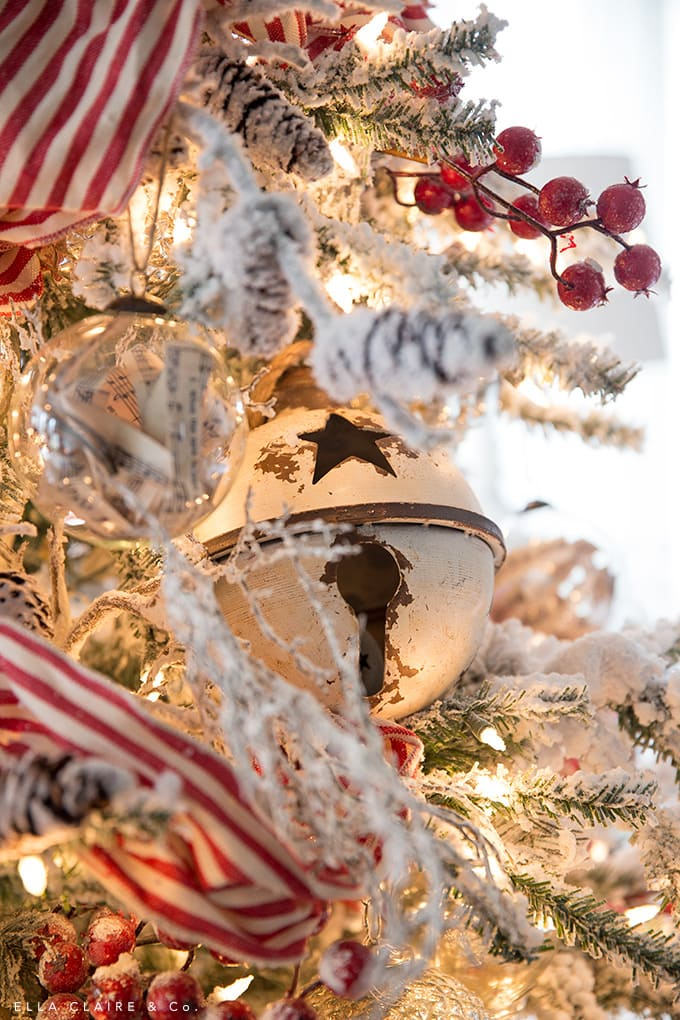 rusty bells in a vintage inspires nostalgic red and white Christmas tree