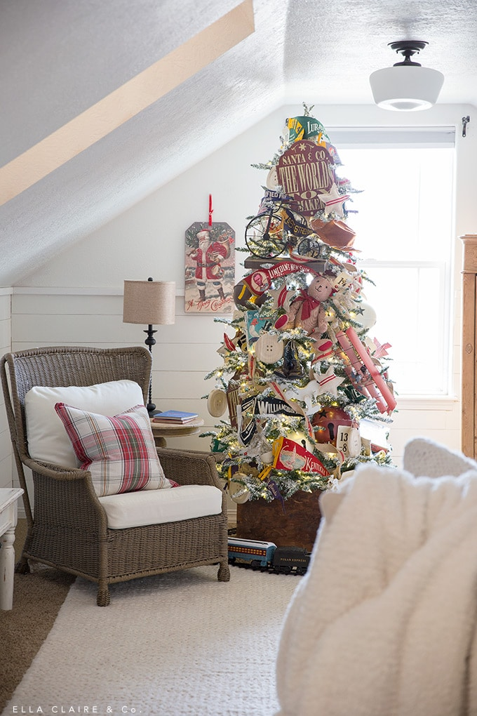 A vintage toy Christmas tree in a family room/ playroom with a nostalgic holiday feel.