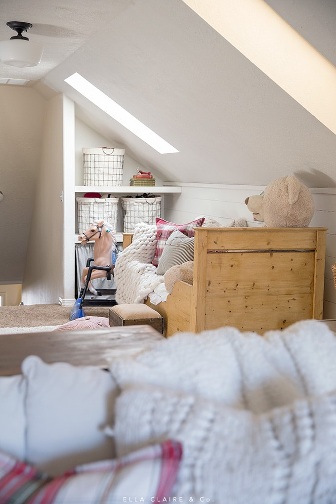 cozy playroom with built in storage shelves decorated for Christmas