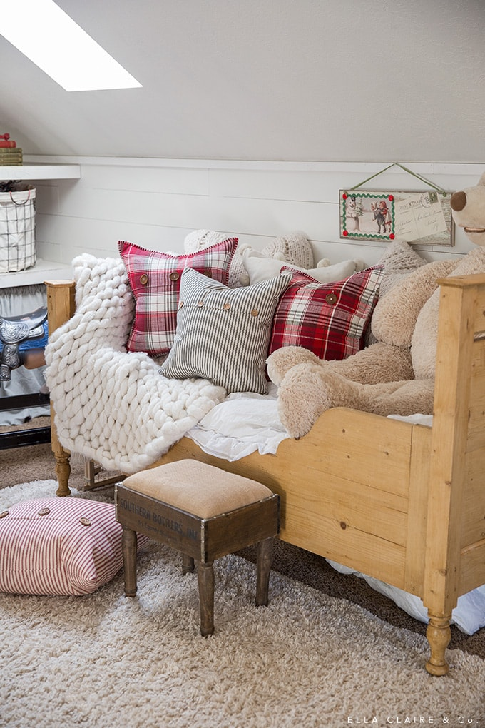 an antique pine bed in a cozy playroom reading nook decorated for vintage farmhouse style Christmas