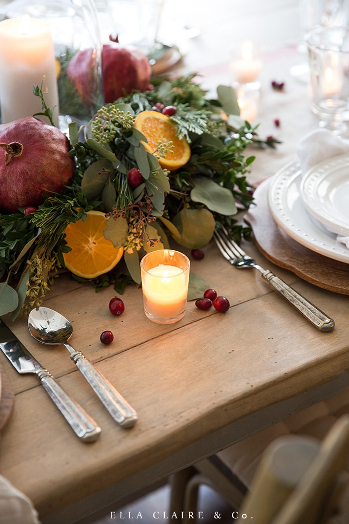warm candlelight is the best accent on a cozy Christmas table while entertaining holiday guests.