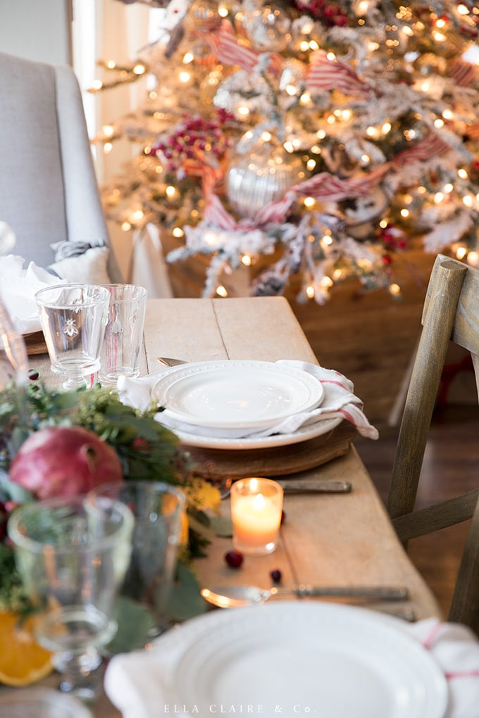 A simple place setting under the glow of the Christmas tree is the perfect way to entertain holiday guests.