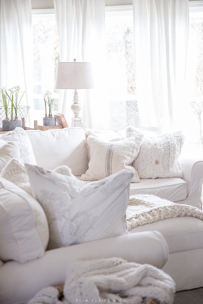 Freshly fluffed spring pillows create an inviting and cozy family living room.