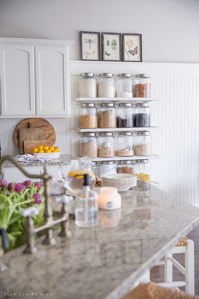 Extra pantry storage in beautiful jars on open shelving- a pretty way to add function and space to a kitchen. The DIY tutorial is very easy to follow!