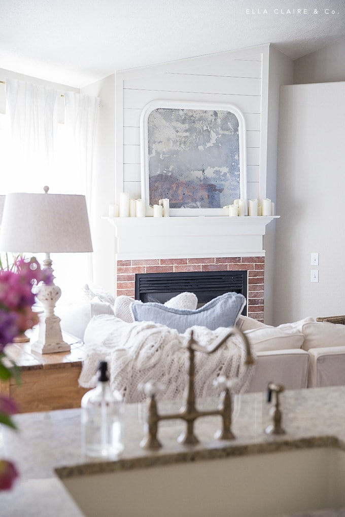 Adding pastel colors (blue pillows) are an easy way to decorate for Easter.
