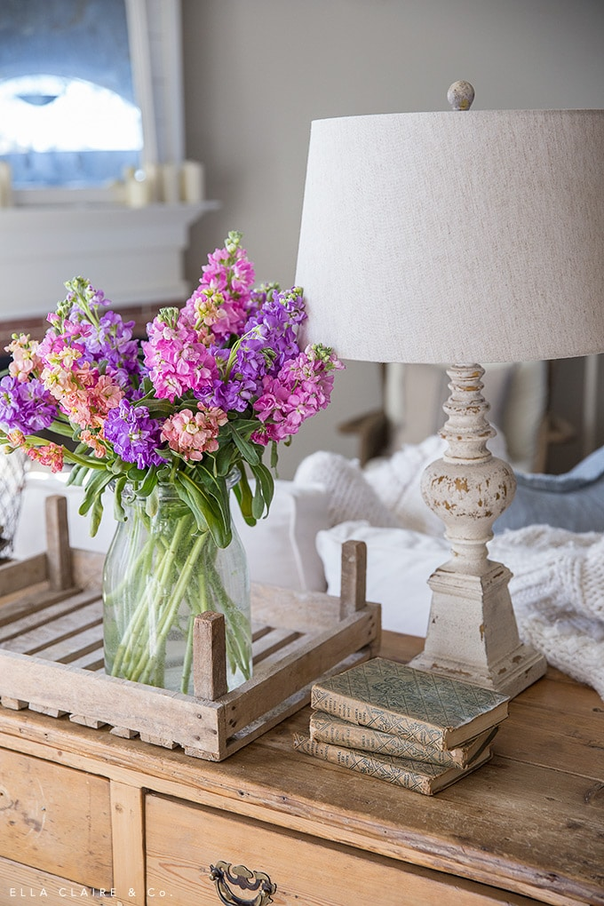 Spring flowers in a rustic wooden trug are a simple Easter decoration