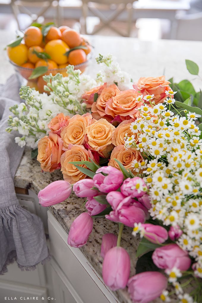 A fresh spring color palette of orange, pink, white, and yellow