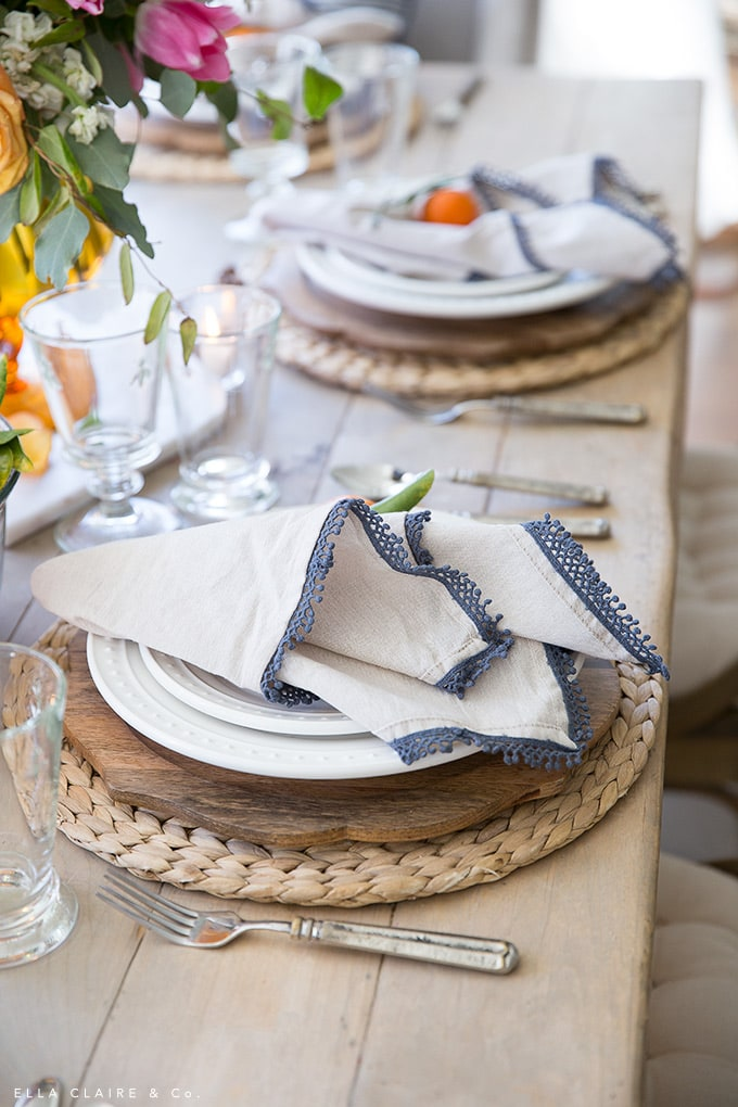 Entertaining is simple and easy when you have neutral staples- napkins, plates, chargers, glassware- on hand. Add a pop of color through flowers and you have a charming table.