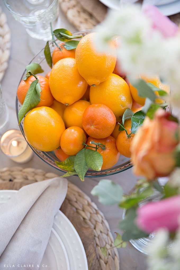 Use pretty fruits- lemons and oranges- as a centerpiece to add color to a spring table.