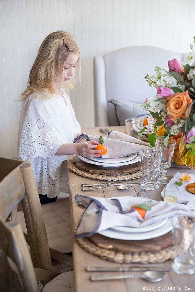 Placing fruit at each place setting adds color and casual charm to a spring table- perfect for simple entertaining.