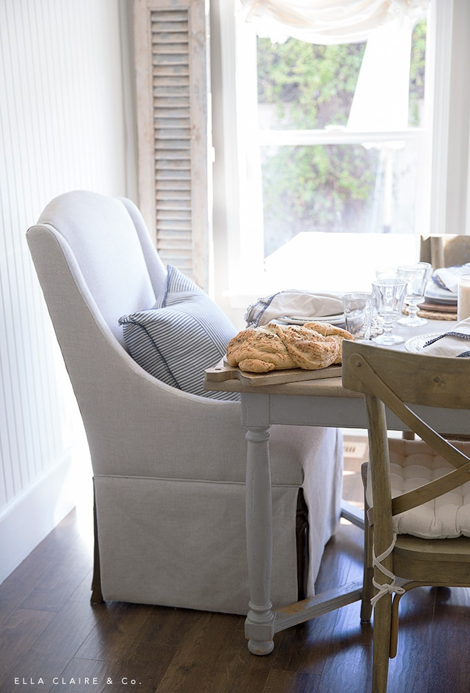 Homemade bread adds cozy layer to a vintage farmhouse inspired table set for spring
