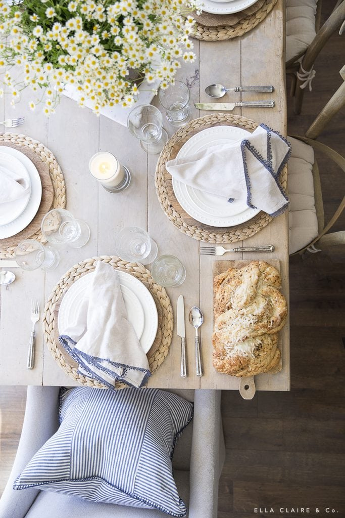 Neutral dishes and casual accents make a french farmhouse inspired table.