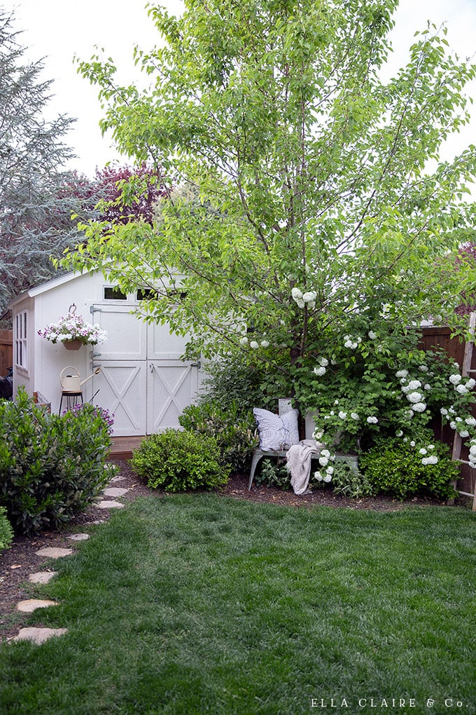 Adding a Cozy Cottage She Shed to a small backyard is possible! Create a beautiful outdoor getaway by turning a shed into an outdoor living space!