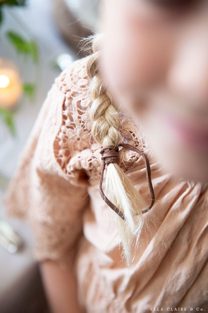 A scrap of leather makes a darling braid tie. Just wrap around the end of the braid tightly and knot. A sweet detain with a vintage inspired outfit.