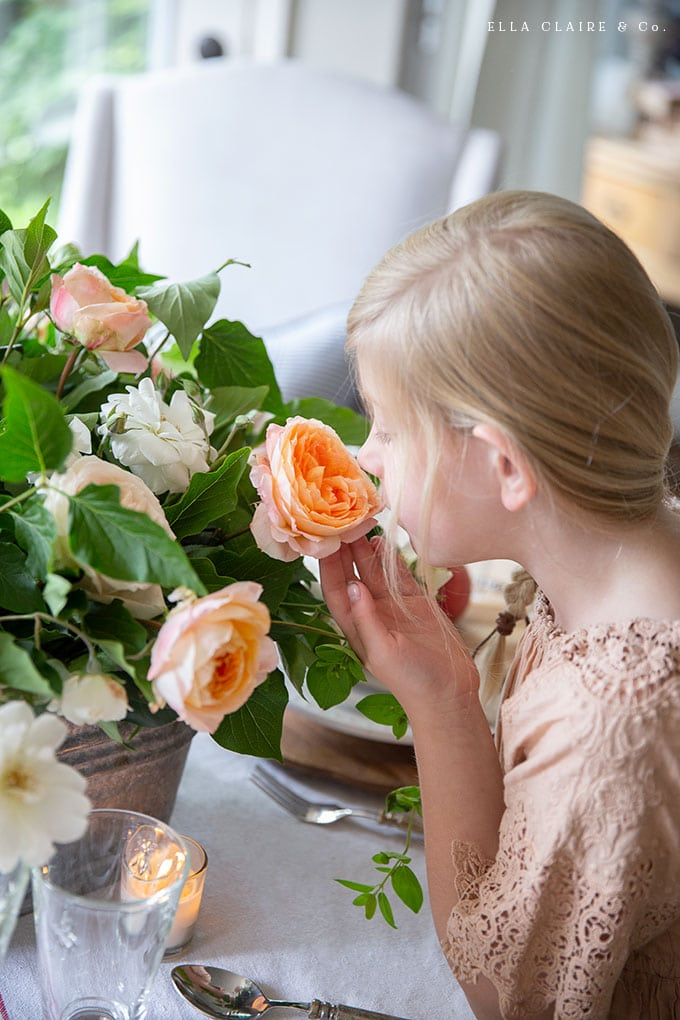 This DIY centerpiece has the sweet smell of garden roses mixed with other yard clippings, creating a casual and elegant flower arrangement for summer entertaining.