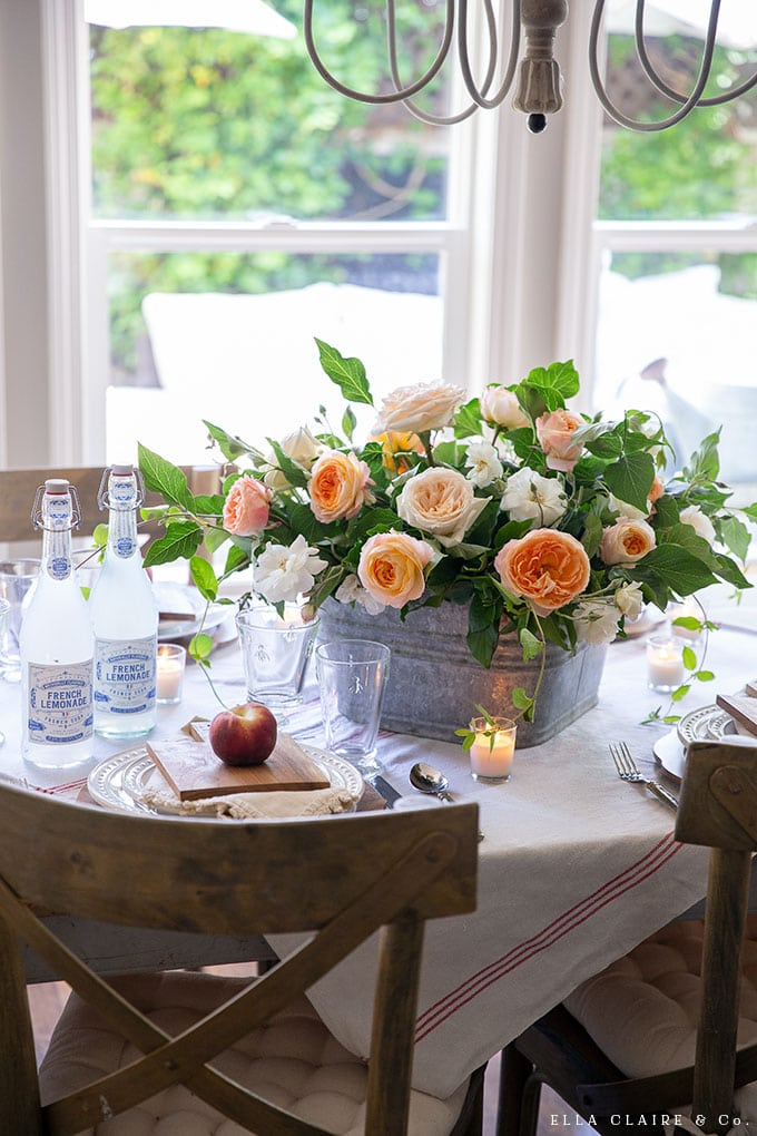 Create this DIY centerpiece that has the sweet smell of garden roses mixed with other yard clippings, creating a casual and elegant flower arrangement for summer entertaining.