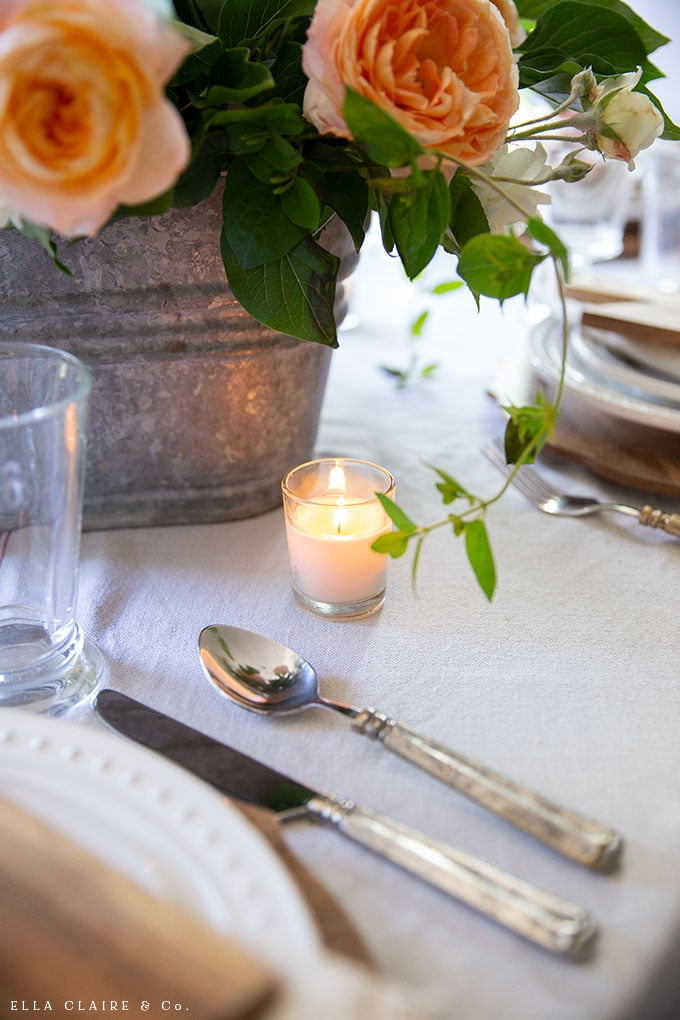 Create this peach harvest tablescape for your summer entertaining. Inexpensive touches add ambiance and vintage charm.