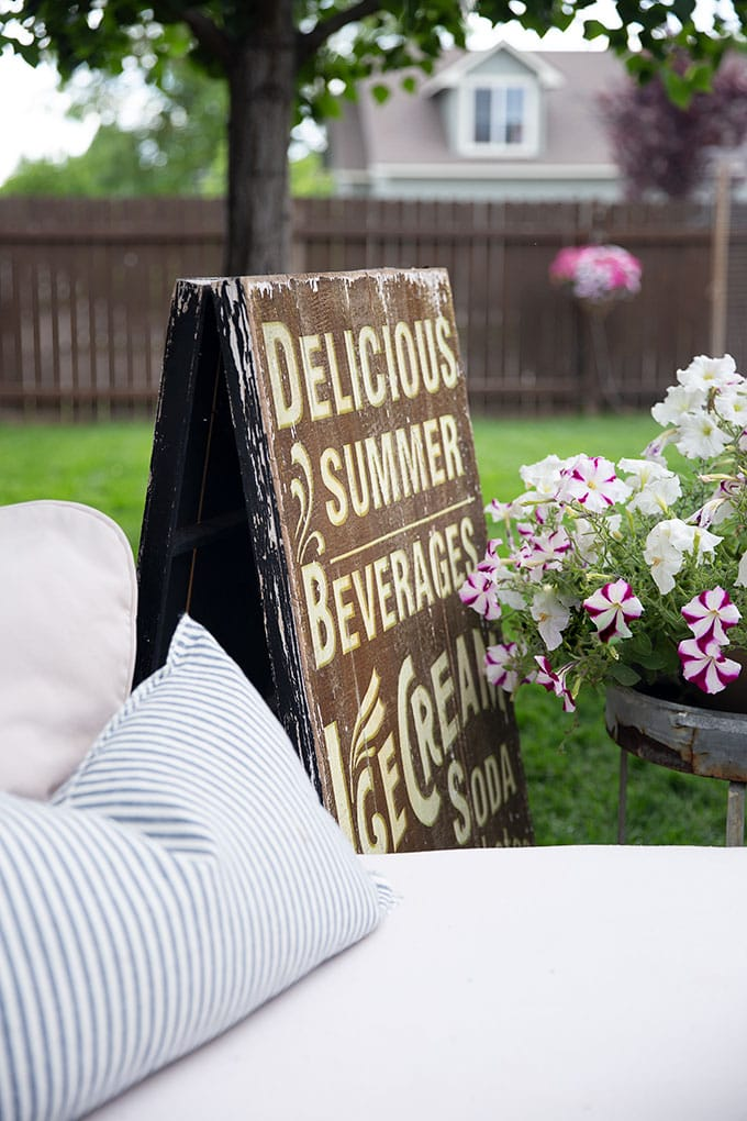 Delicious summer beverages, ice cream soda sign is a fun and whimsical addition to this vintage French farmhouse patio decor.