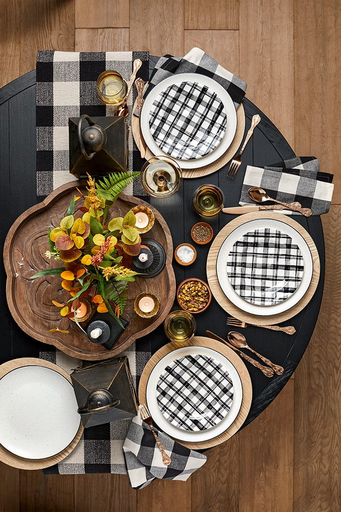 black and white fall tablescape with warm and cozy warm toned Autumn touches- a rustic farmhouse feel.