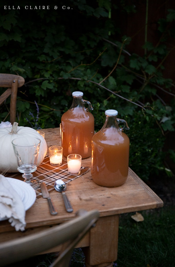 Fresh pressed apple cider is a delicious and beautiful table accent for fall entertaining