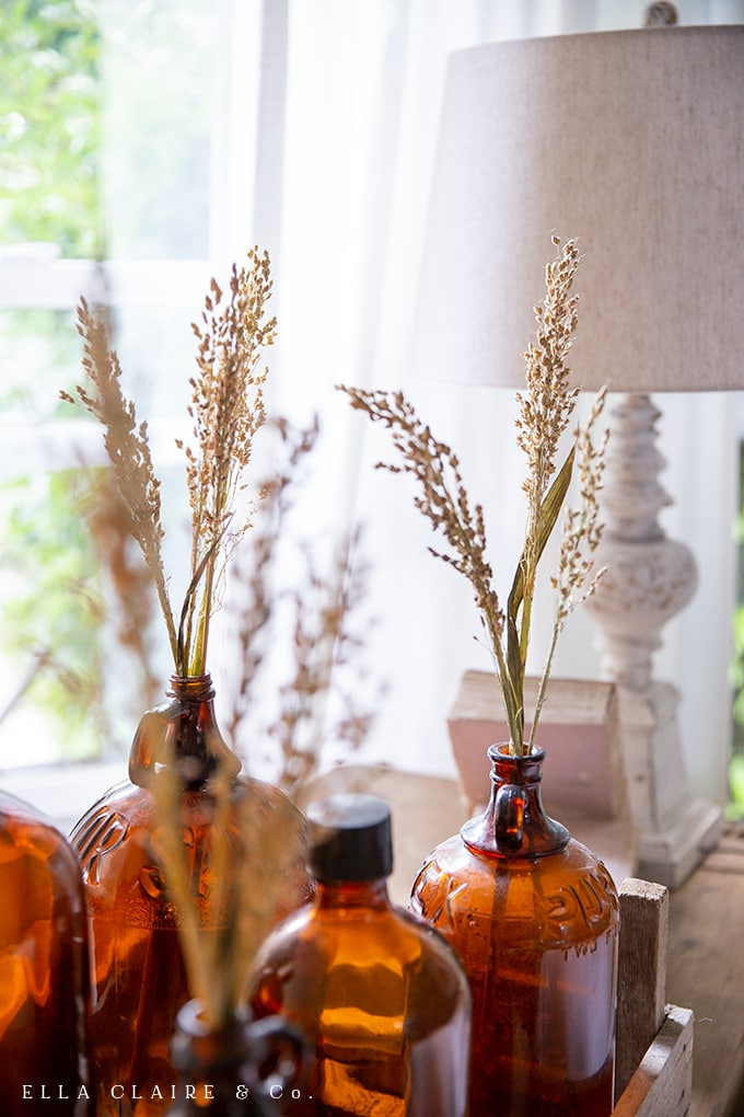 sprigs of broomcorn in thrifted vintage amber glass bottles