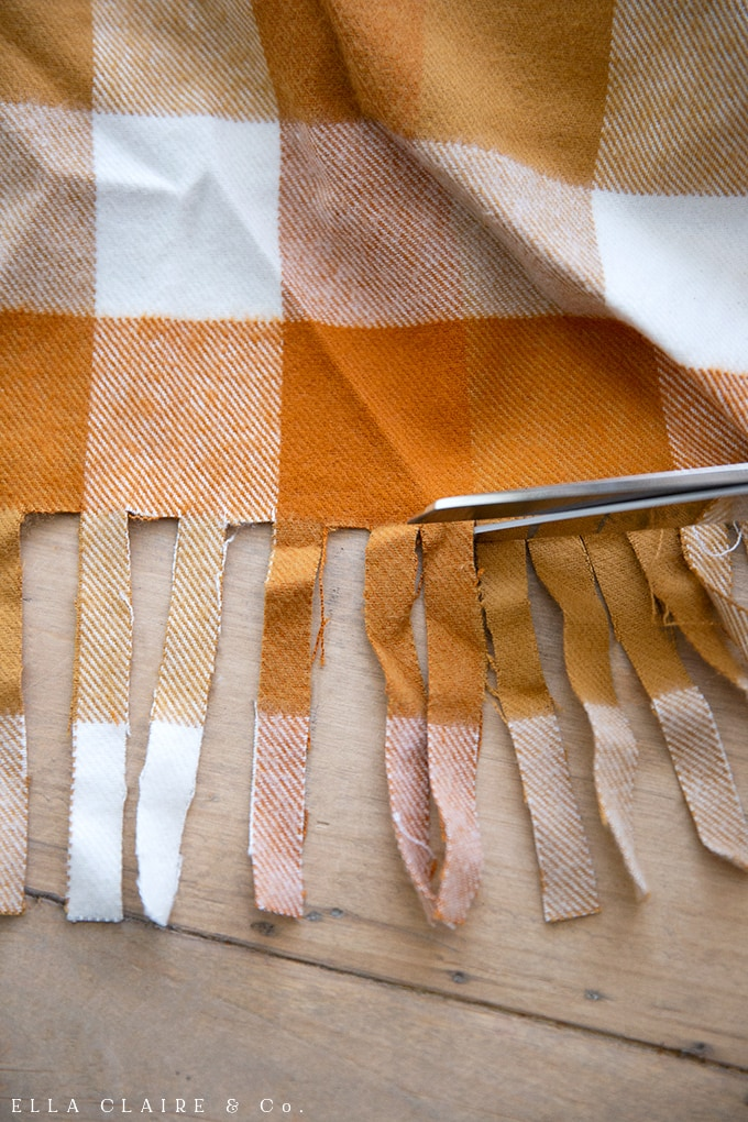 step by step tutorial for creating an easy DIY fringed throw blanket