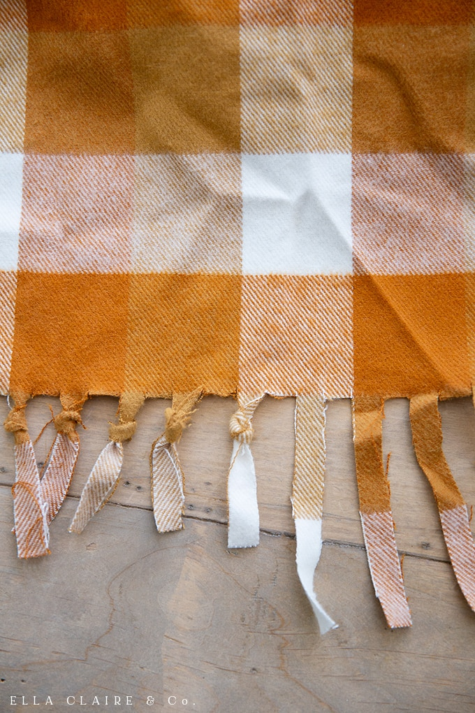 making an easy DIY flannel throw blanket or table square