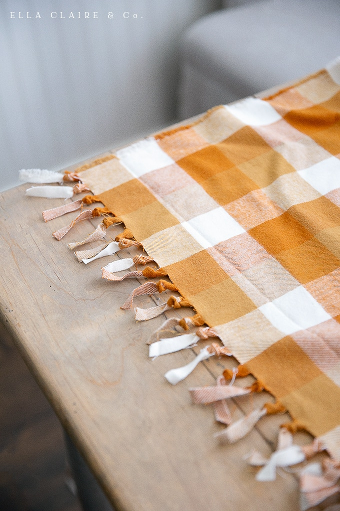 knotted fringed edge on an easy DIY tablecloth or flannel throw blanket