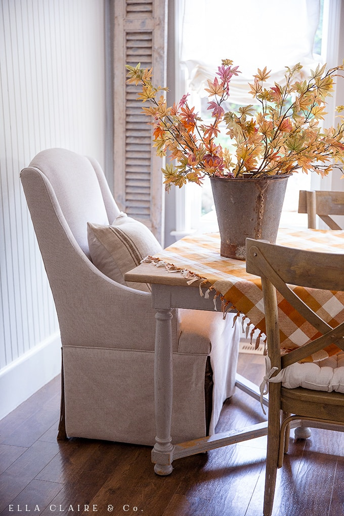 A cozy fall table with an easy DIY tablecloth/ table square with a knotted fringed edge