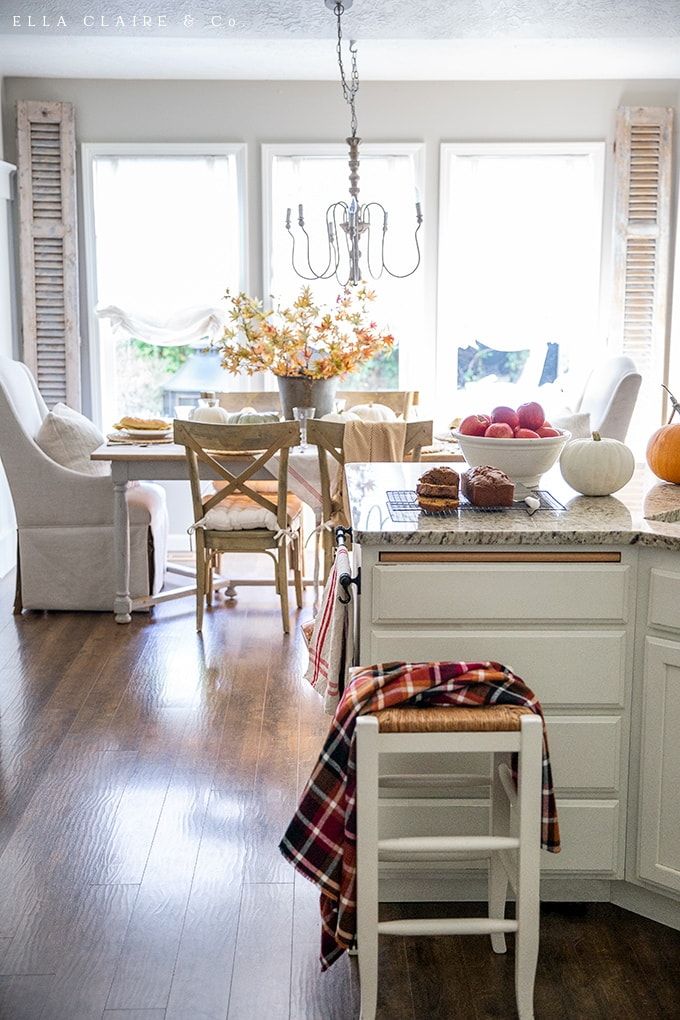 rustic and natural elements create a cozy fall kitchen and dining area